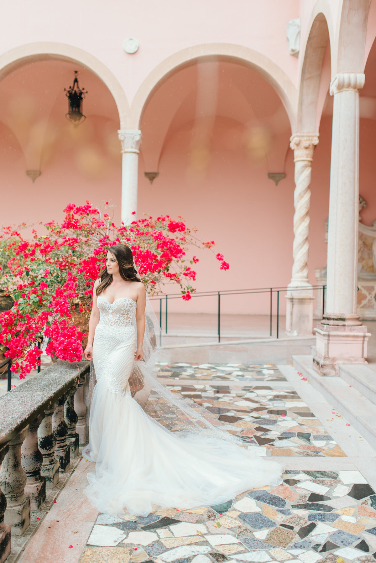 Bride in luxury wedding dress with bougainvillea flowers