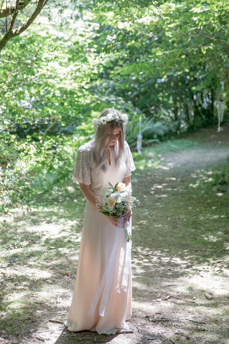 Bride in the woods at The Green Weddings in Cornwall