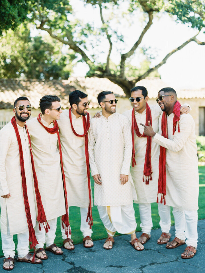 indian wedding men wearing white kurtas
