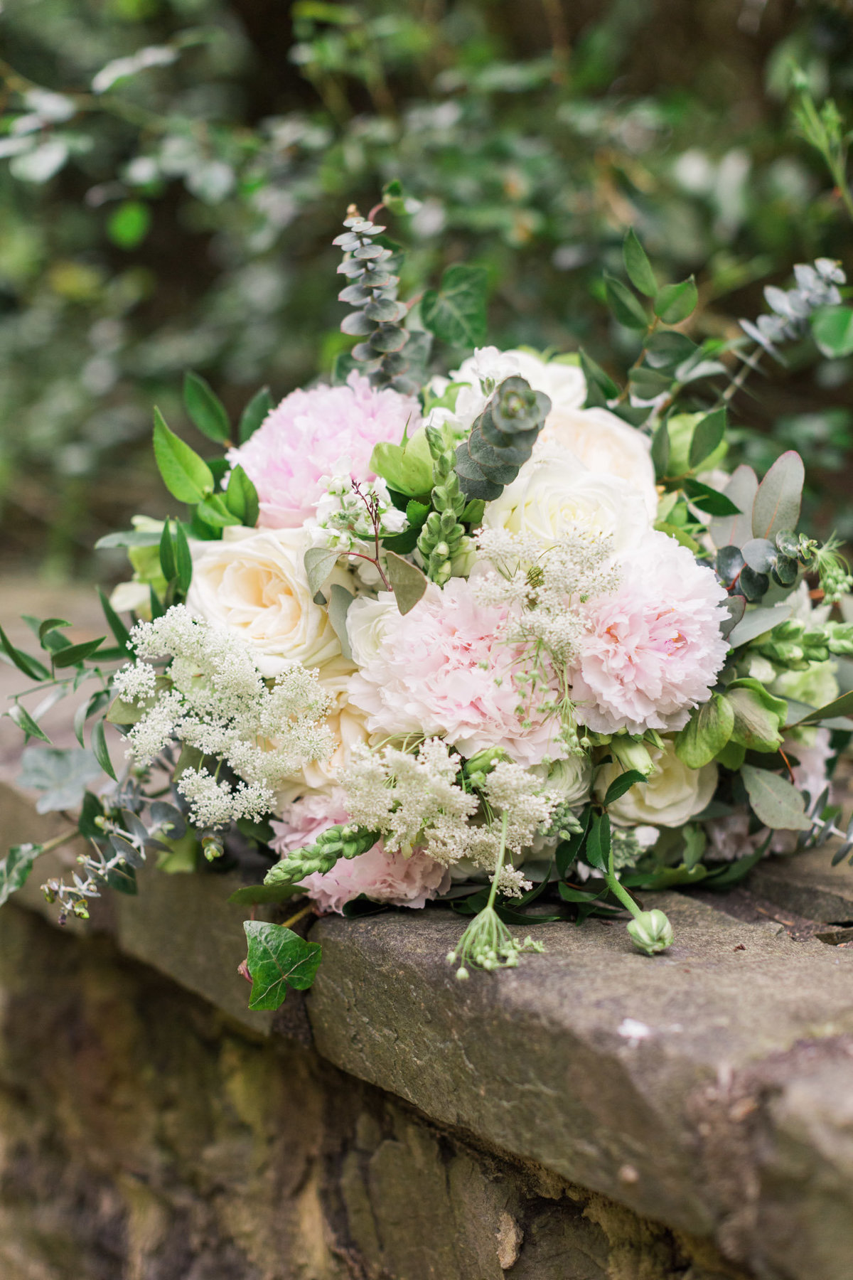 This bridal bouquet was made up of peonies and roses. Photo by luxury destination wedding photographer Rebecca Cerasani.