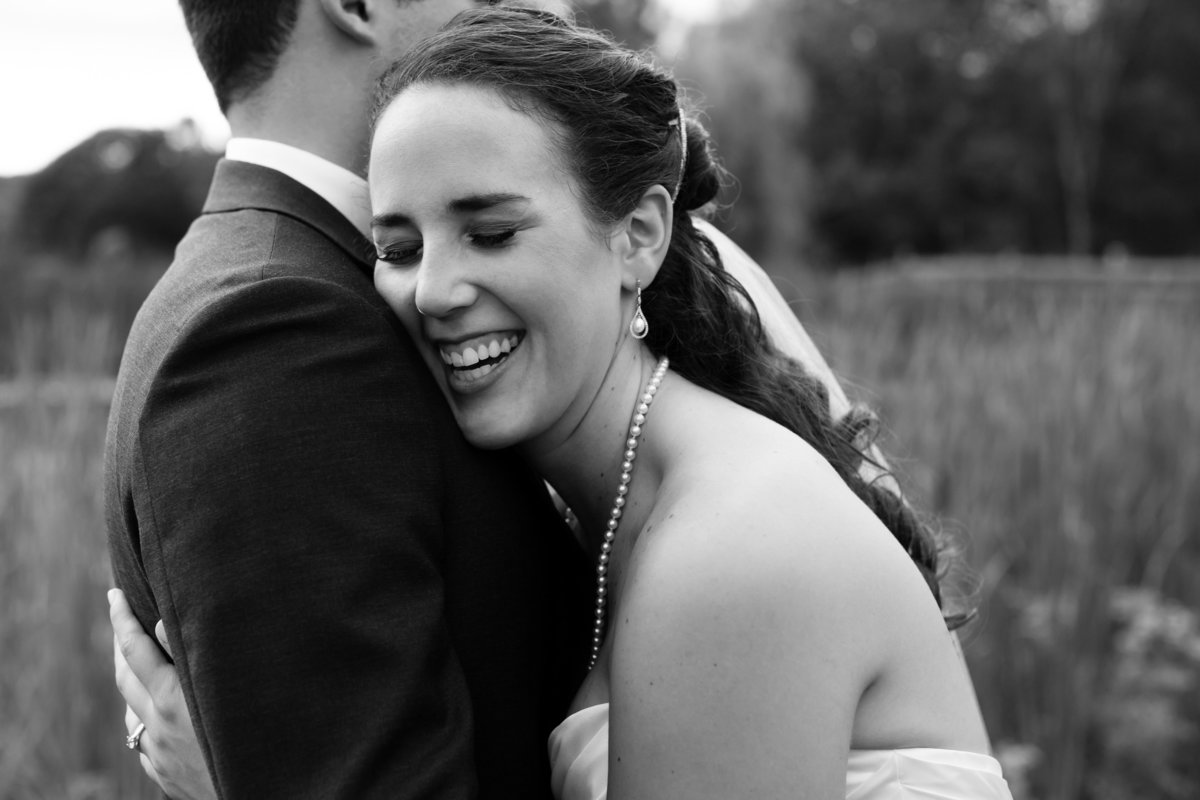 The bride laughs with her groom after their ceremony at Clark's Cove Farm in Maine