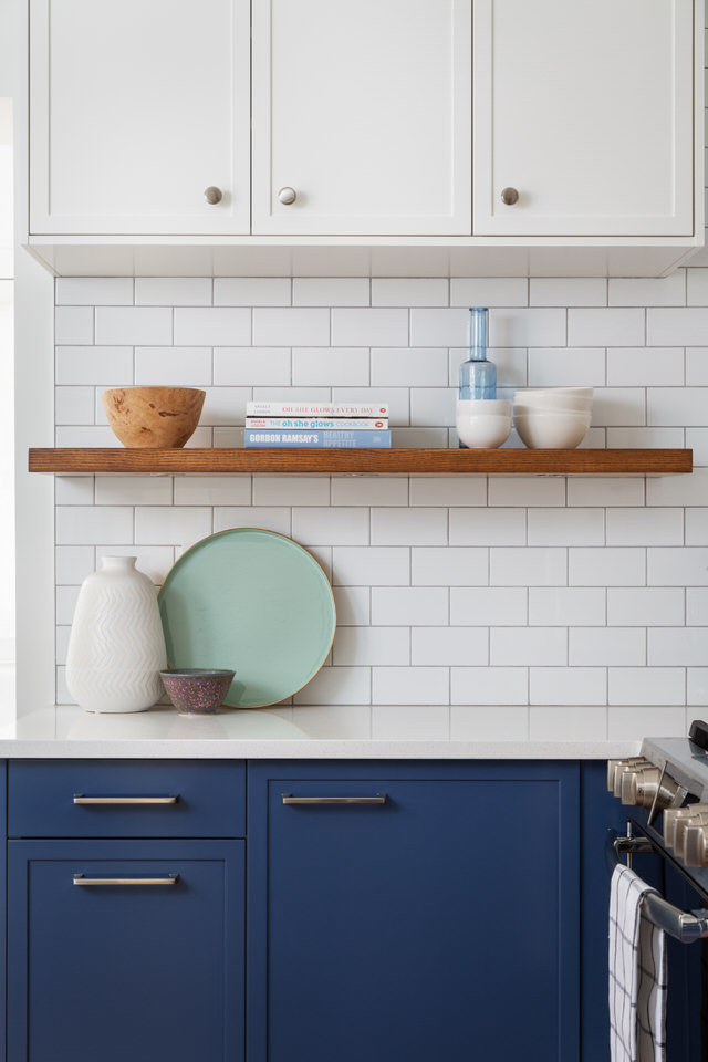 Two-tone kitchen cabinets - subway tiles- floating shelf