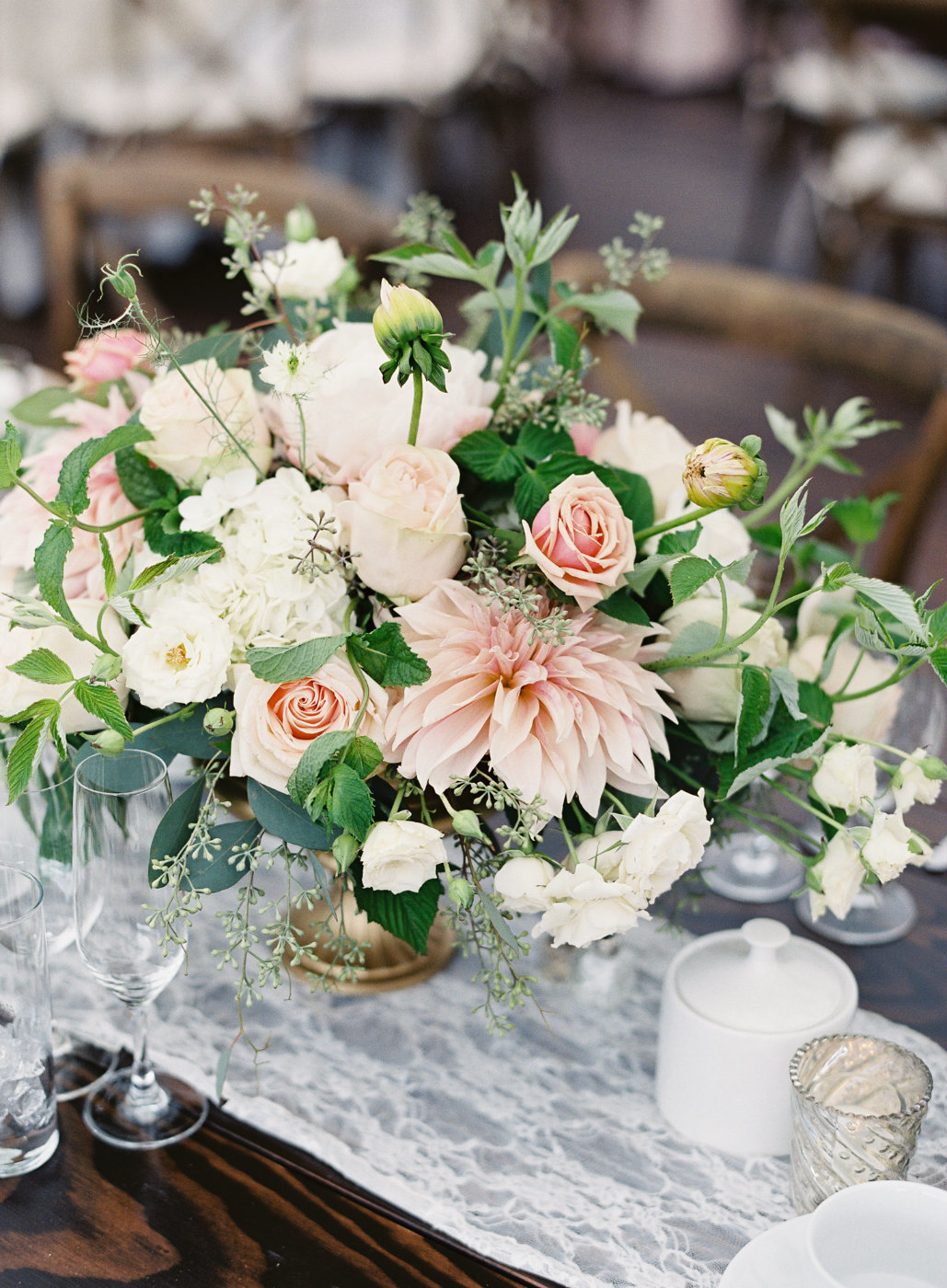 Gorgeous blush and cream wedding with garden greens at a luxury tent wedding.