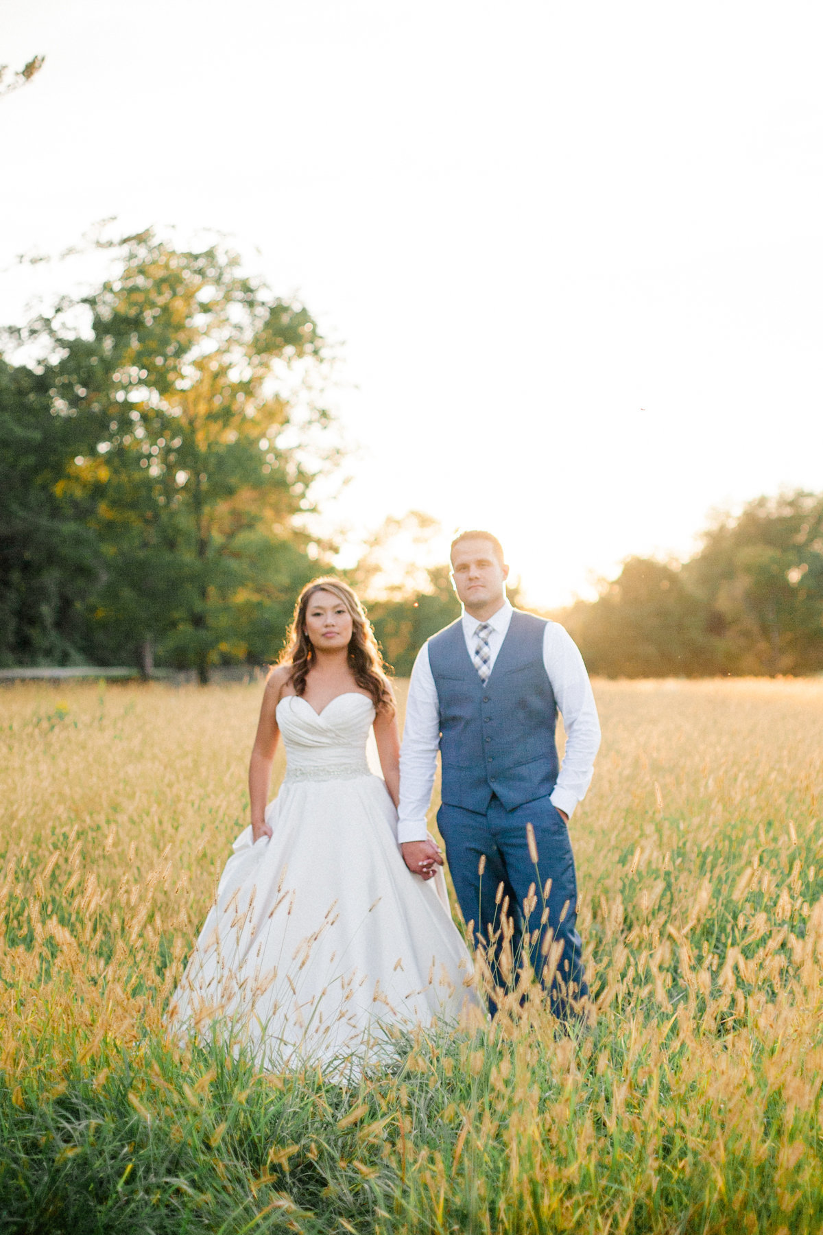 taryn christine photography wedding photographer mayowood stone barn couple stands hand in hand