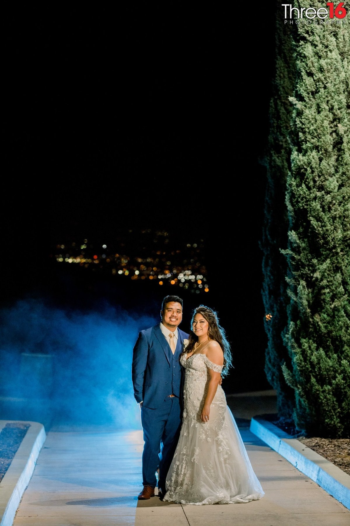 Bride and Groom pose together for a night shot
