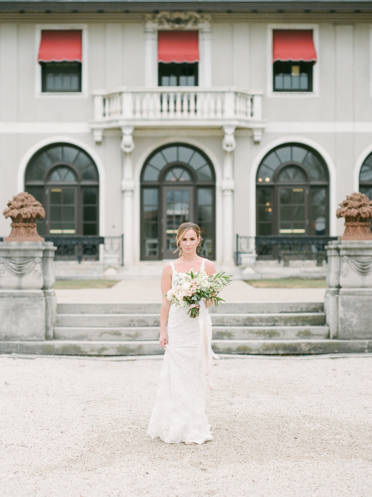 bride walking in front of mansion