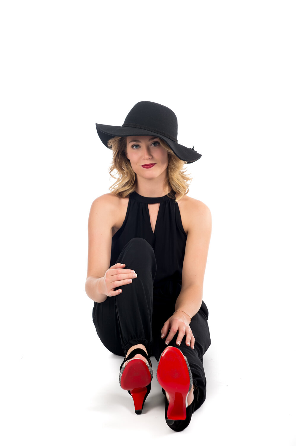 white background senior girl  hat red shoes