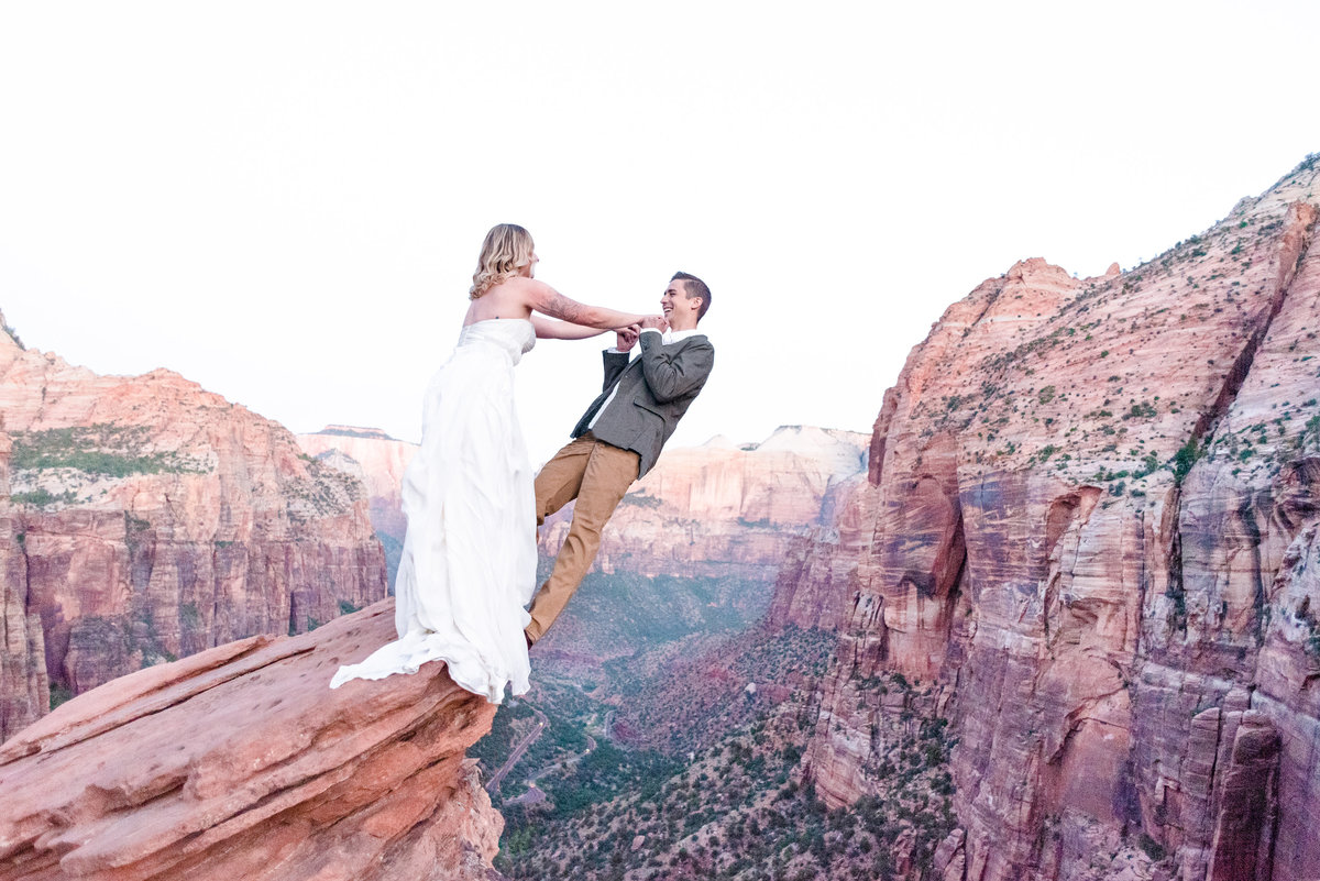 bride dangles groom off of cliff at zion national park