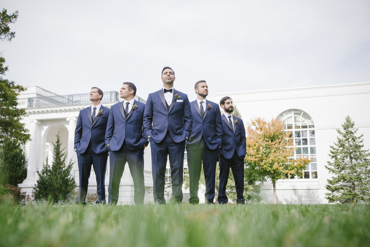 groomsmen standing in front of monmouth university