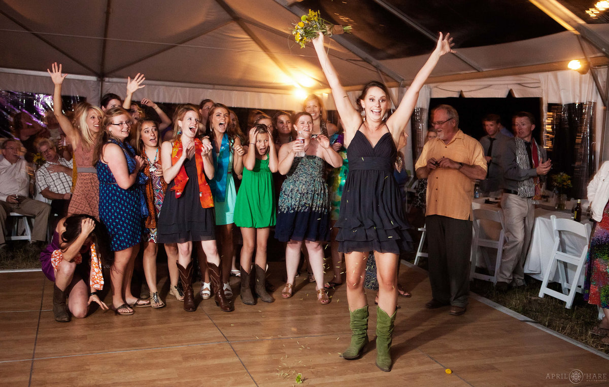 Bouquet Toss at a Fun Steamboat Springs Wedding in Colorado