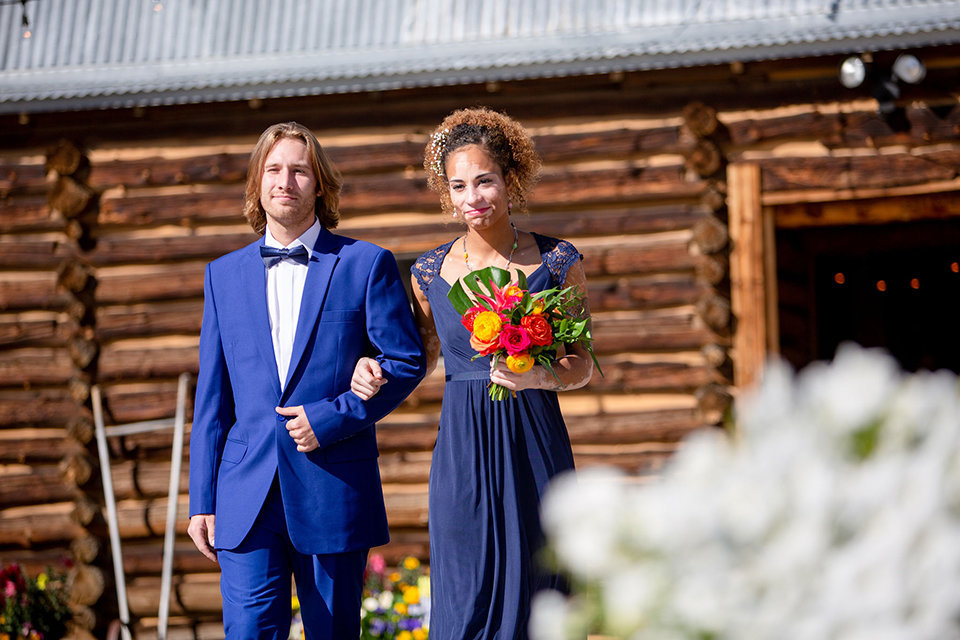 granby-colorado-Strawberry-Creek-Ranch-Wedding-Ashley-McKenzie-Photography-tropic-meets-mountain-wedding-colorful-bridesmaid-with-groomsman-in-hand
