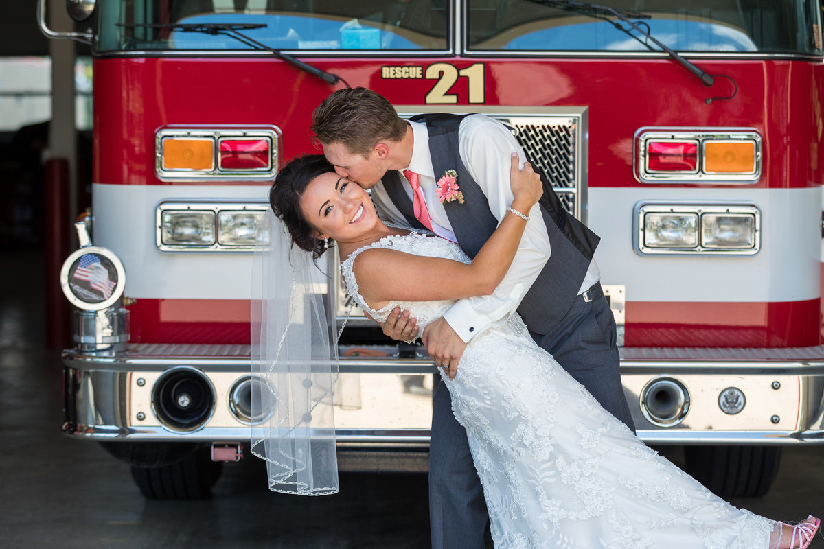 Wedding Photography - Blake, being a volunteer fireman, wanted to incorporate his fire house and they were just the sweetest couple in the world here to get incredible shots!