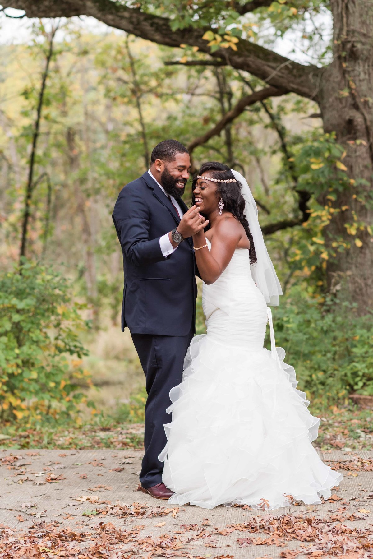 Black wedding couple dancing and laughing during portrait time.