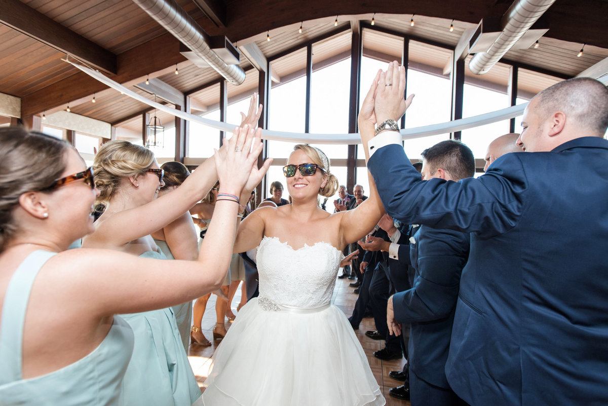 bride and bridal party dancing with sunglasses during wedding reception at Pavilion at Sunken Meadow