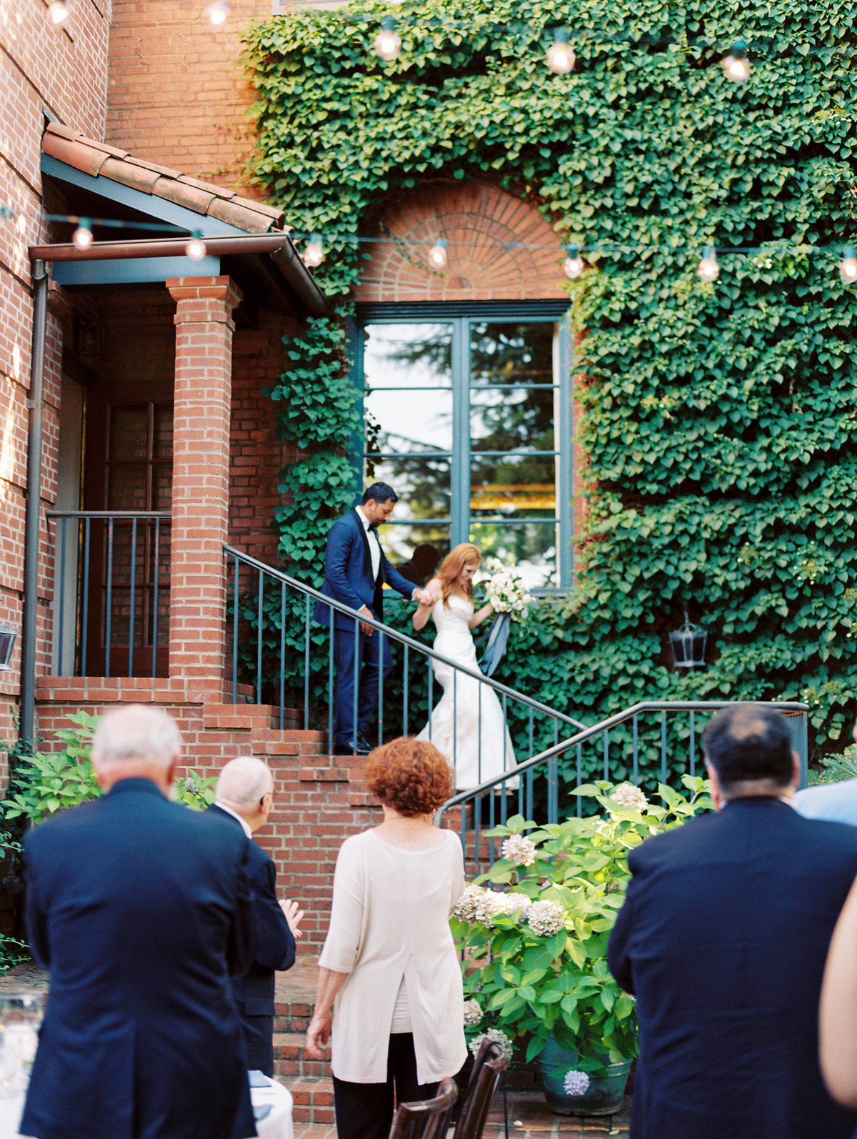bride and groom's grand entrance at the town club in portland