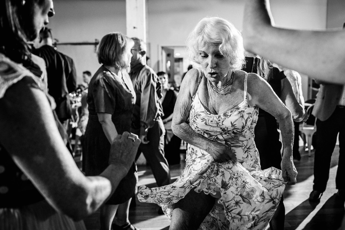 Grandma dances with guests at a Joinery wedding in Chicago.