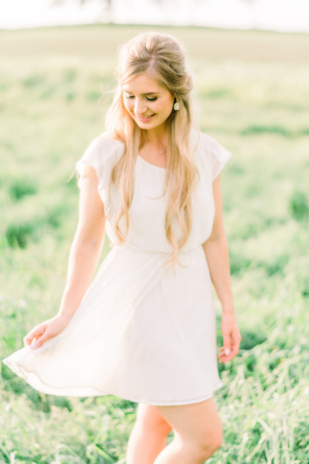 Girl in a pasture with flowy dress
