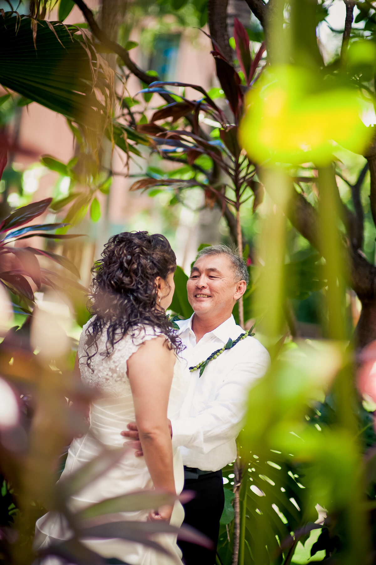Bride and Groom Have a Candid Moment at the Royal Hawaiian Hotel