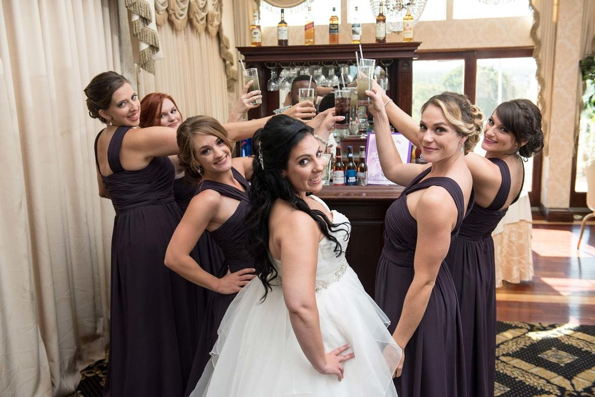 Bridesmaids doing a shot at Giorgio's Catering