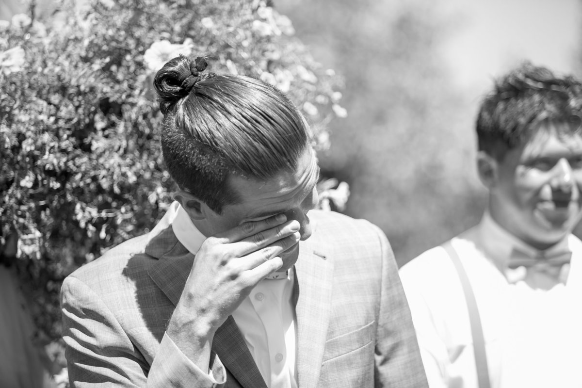 Groom crying as he sees his bride walking down the aisle