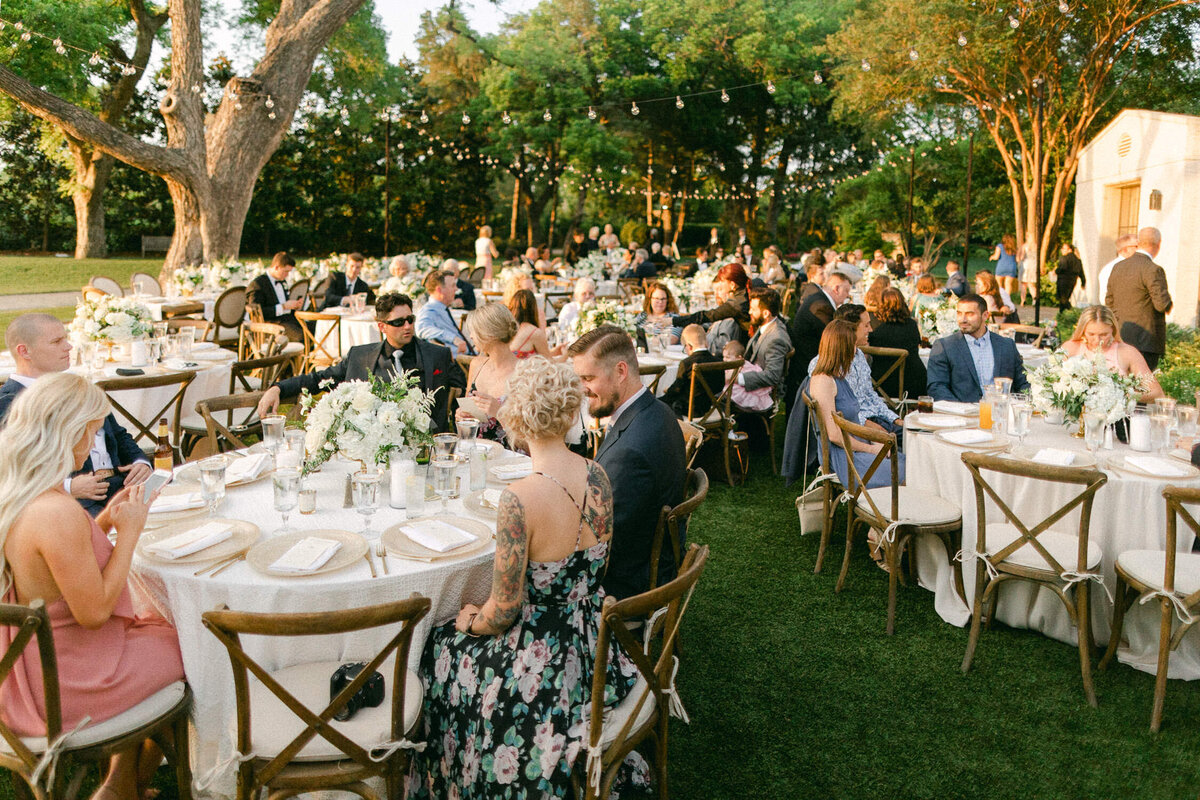 outdoor garden wedding reception guests sitting at tables