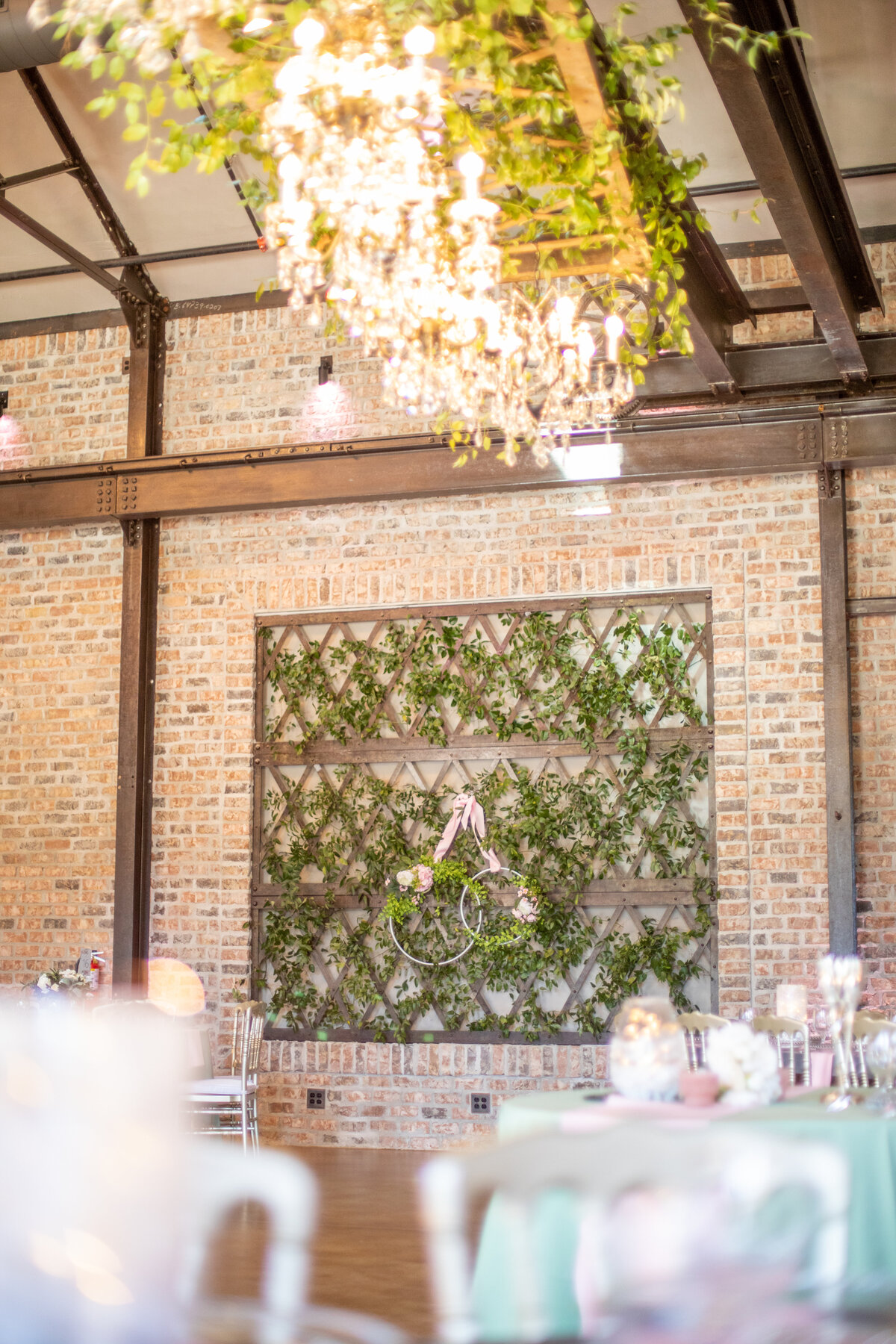 Industrial Venue Decorated with Greenery at Iron Manor