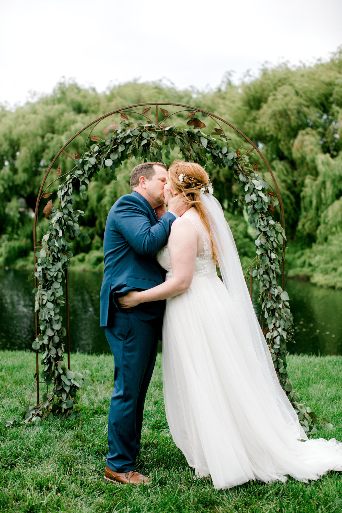 Bride and groom first kiss as husband and wife at Olympias Valley Estate in Petaluma California