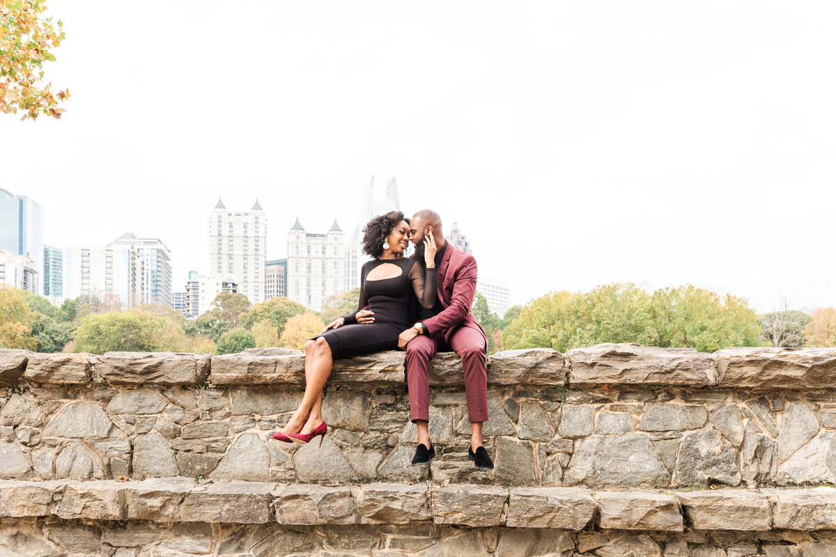 A black couple at their engagement session at Piedmont Park in Atlanta Georgia by Jennifer Marie Studios, best Atlanta wedding photographer.