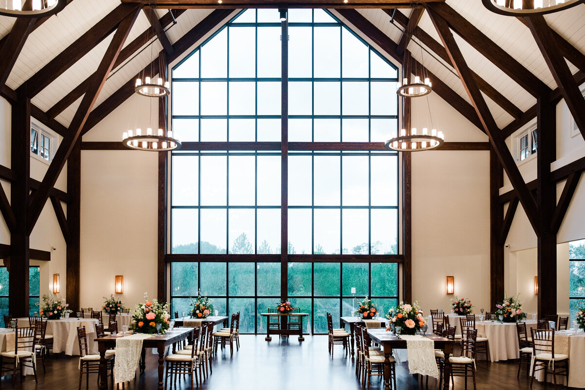Expansive view of the reception space featuring floor to ceiling windows and wood beams