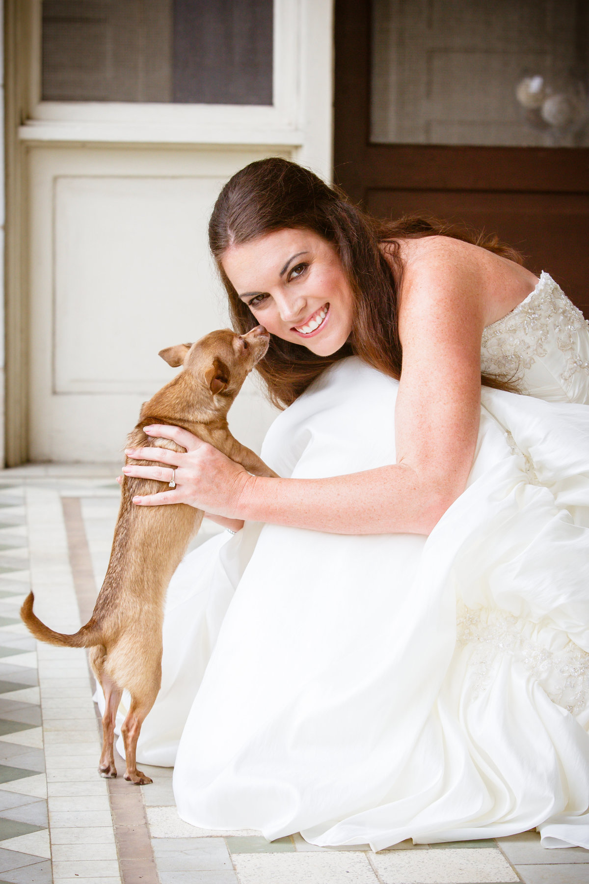 Lindsay Coulter's bridal photo with her dog Lucy before her wedding to George Zoghby in Mobile, Alabama.