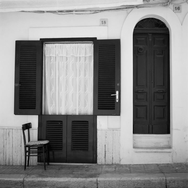 black and white photo of rom front door