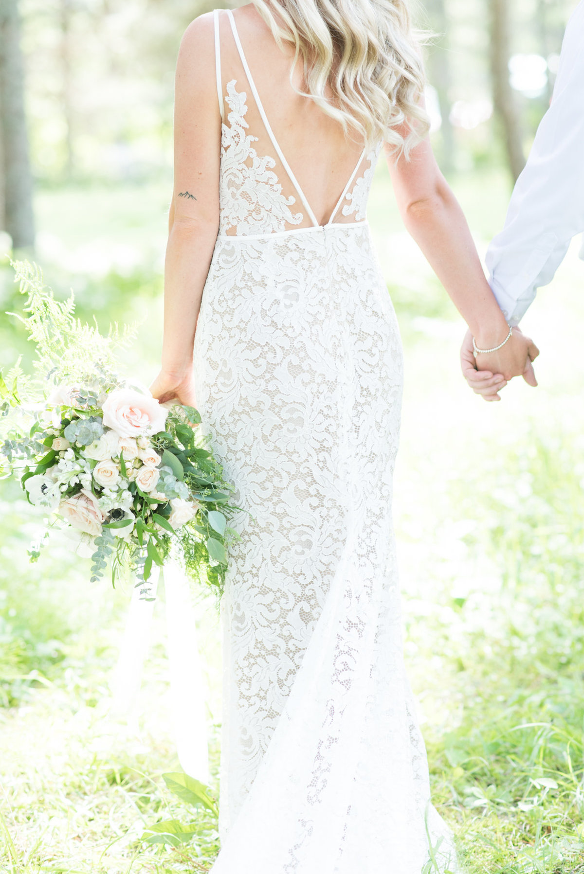 Back of Watters wedding gown  and bouquet designed by Velvet Rope Floral in Thunder Bay