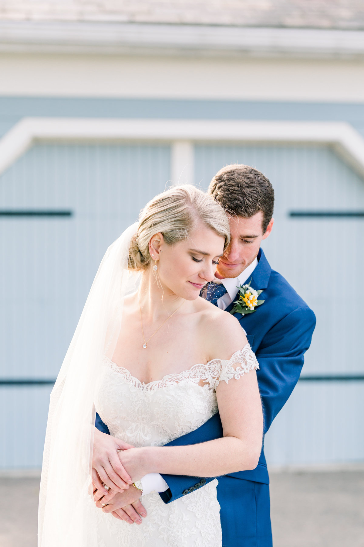 Bride and Groom hold each other at Ohio wedding at Pretty Prairie Farm