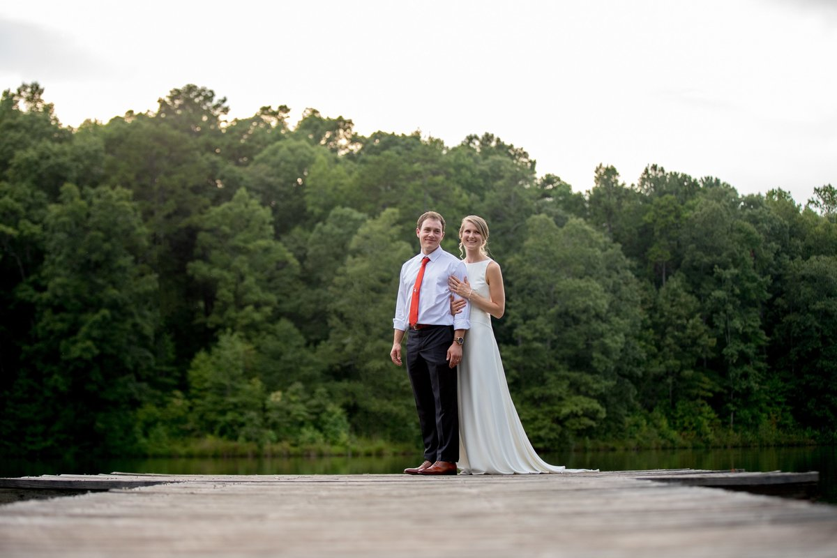 Bride and Groom posing on dock