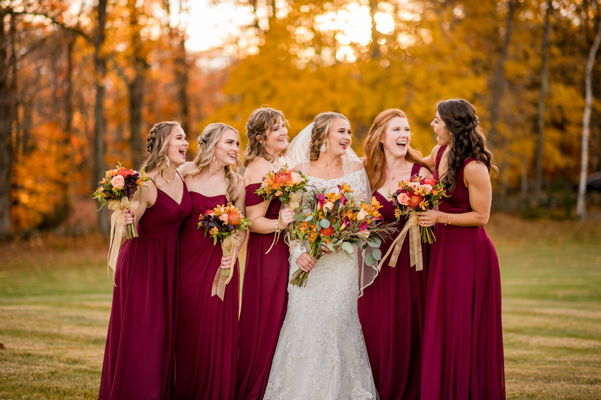 laughing bride with her bridesmaids