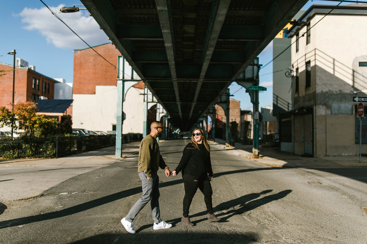 couple walking on front street in fishtown