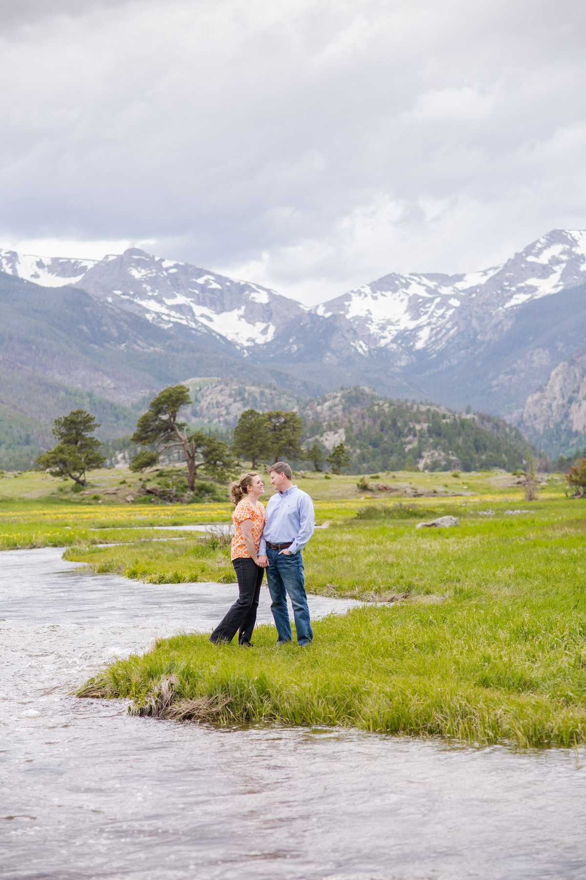 RMNP photos of engaged couple and mountains