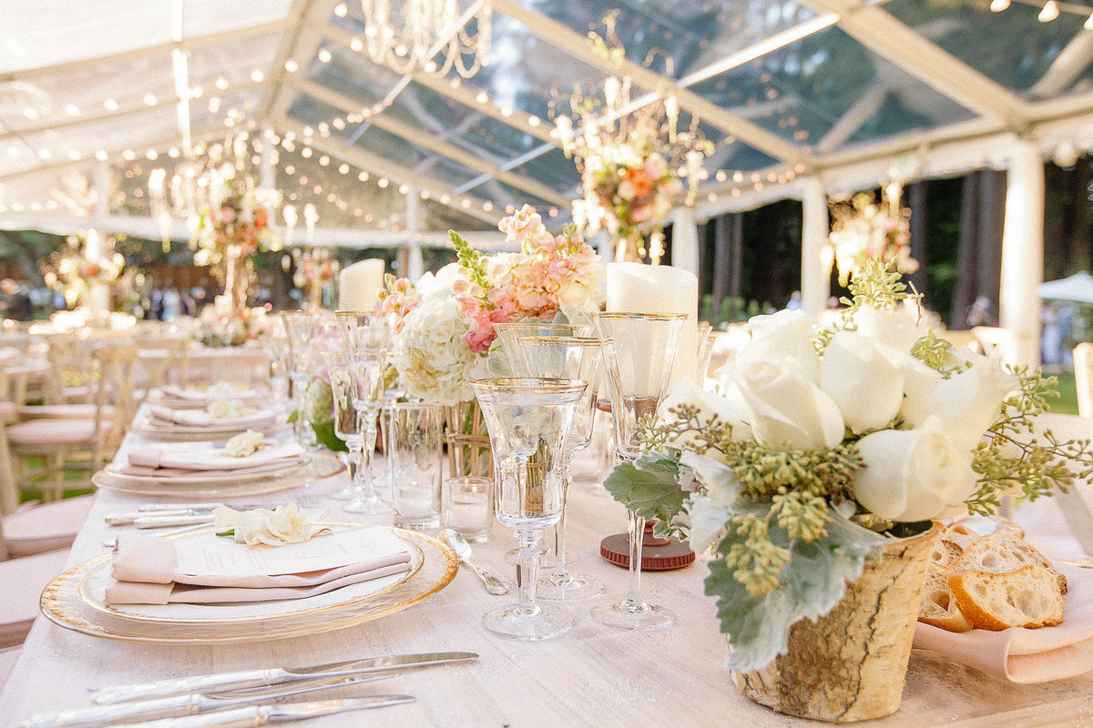 A white and blush tabletop and clear tent for a wedding at The Family Farm in Woodside, Ca.