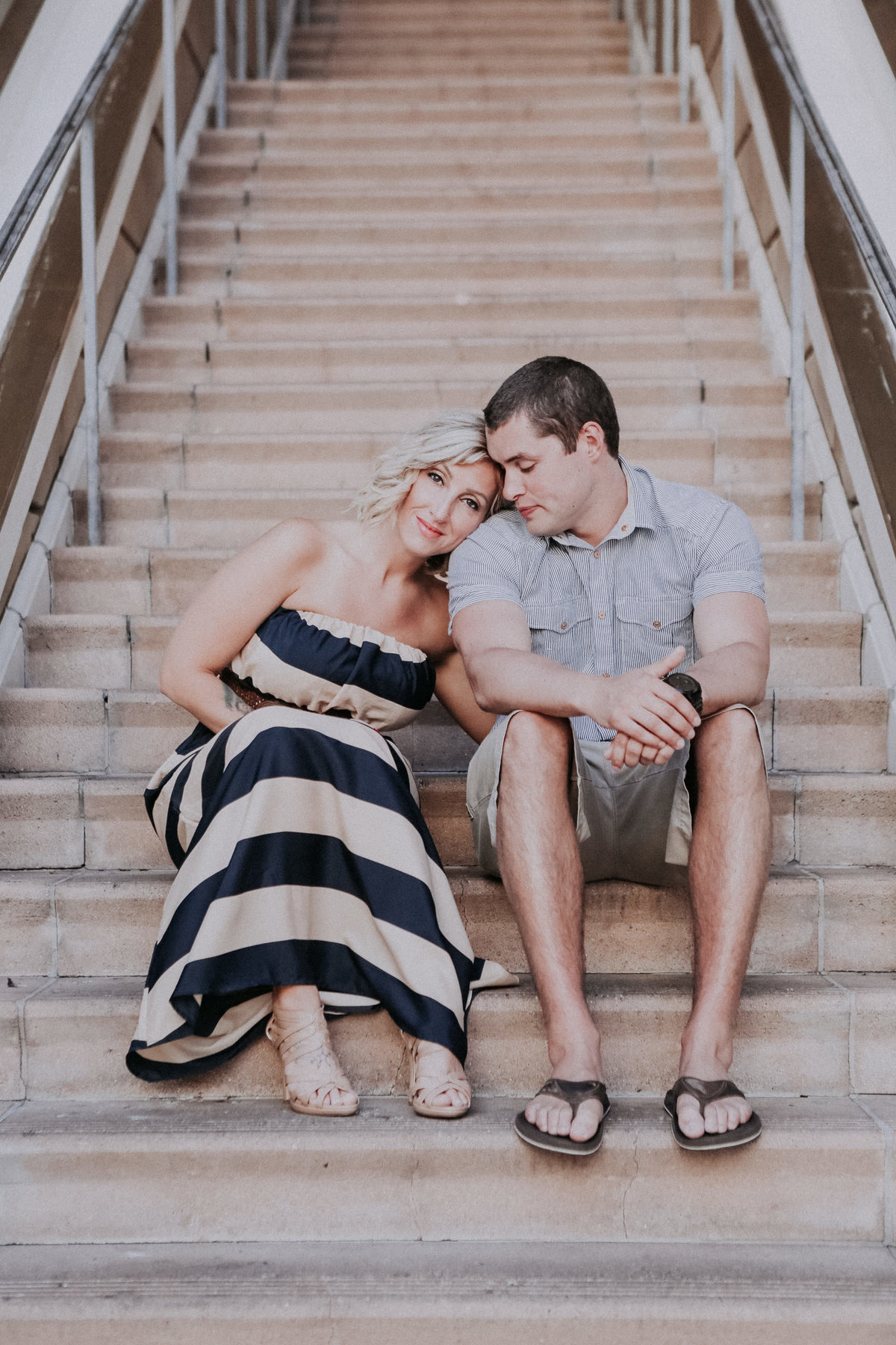 LAke Tahoe engagement pictures couple poses on stairs together