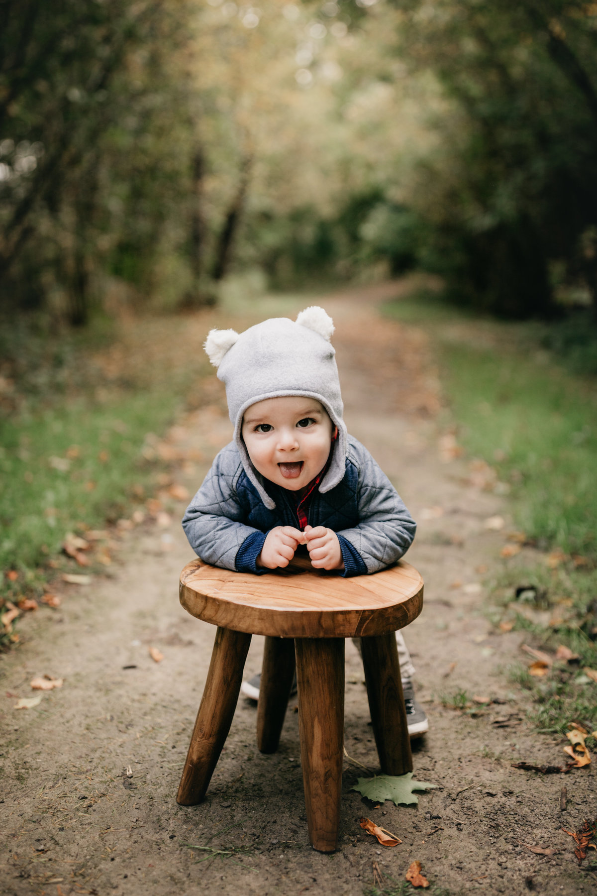 Little boy on a stool in the woods