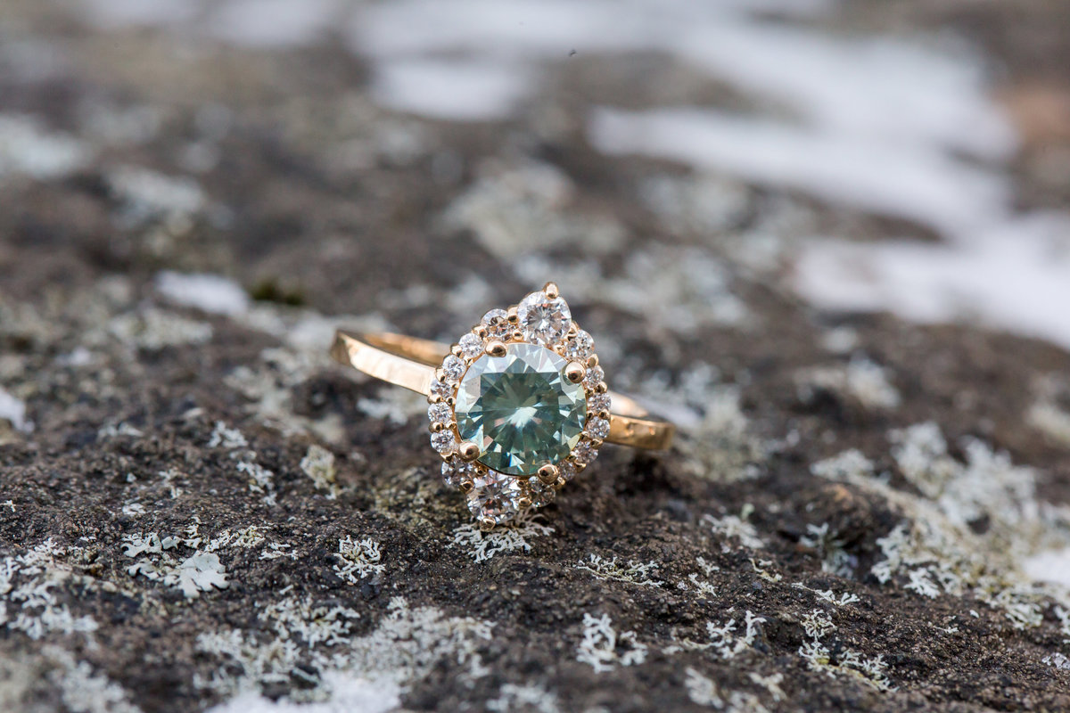 A beautiful engagement ring sits atop a rock at Wintergreen Resort
