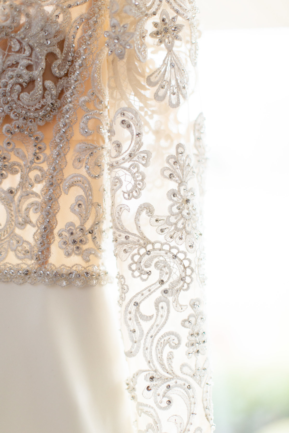 detail photo of bride's sleeve