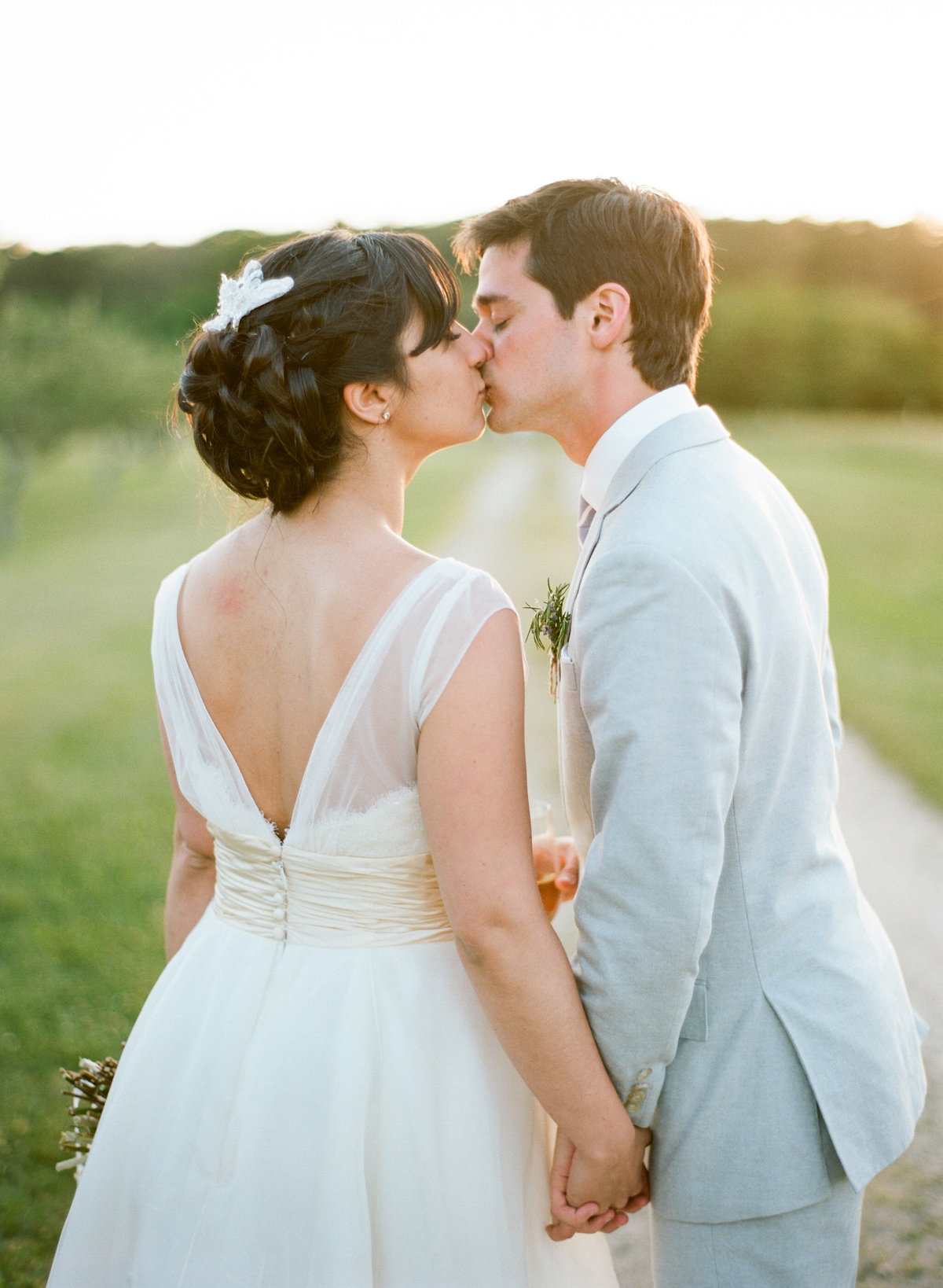Bride and groom kiss golden hour