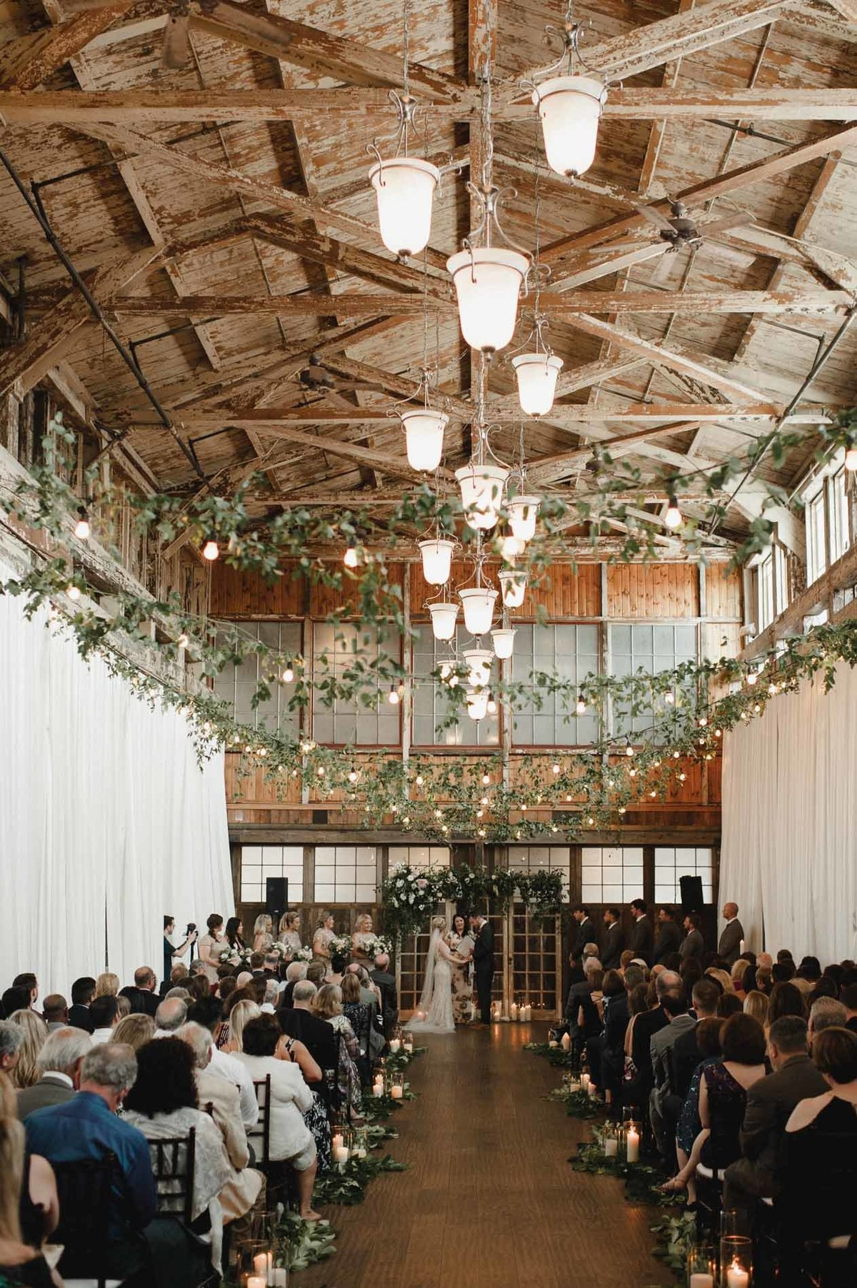 Delicate vines hang throughout the ceremony space created by Flora Nova Design in Seattle