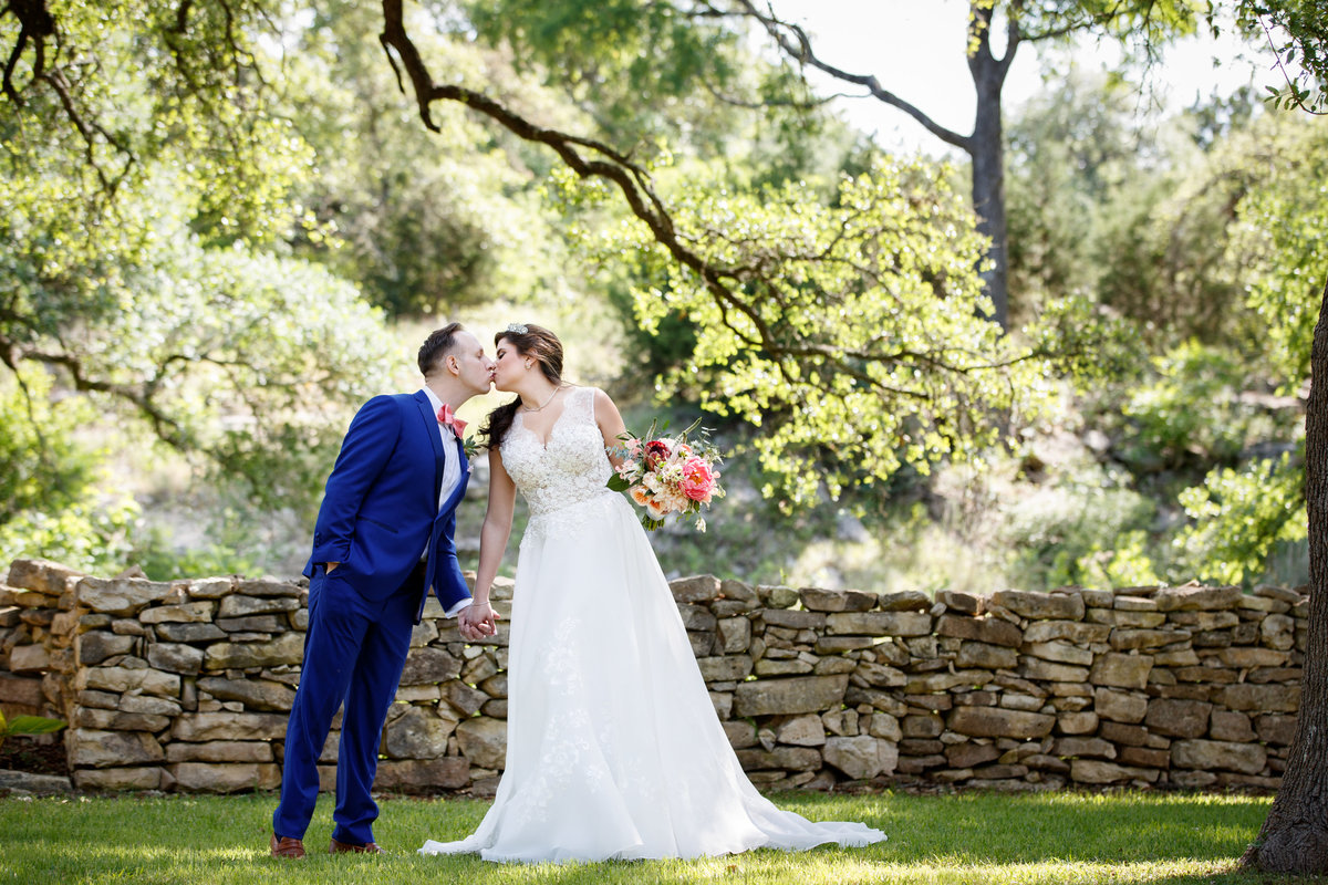 Addison grove wedding photographer bride groom kiss first look 11903 Fitzhugh Rd, Austin, TX 78736