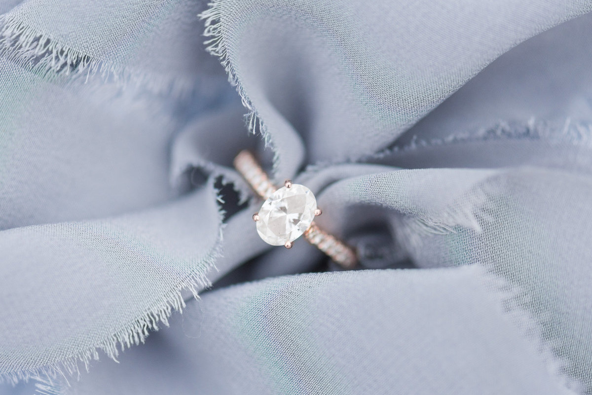 elegant-dusty-blue-engagement-ring-photo