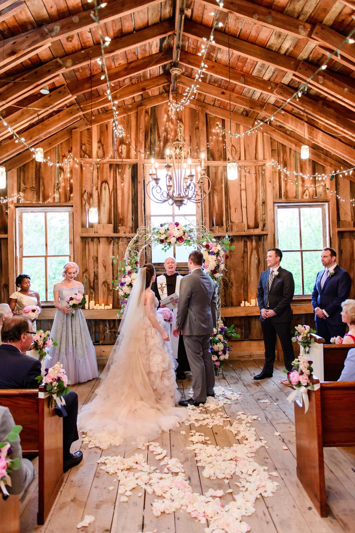 Wedding ceremony in barn at glasgow farms virginia