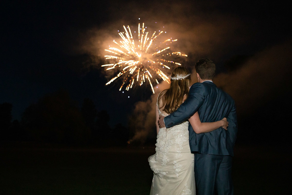 Bride and Groom with fireworks   at Forde House wedding in Somerset_
