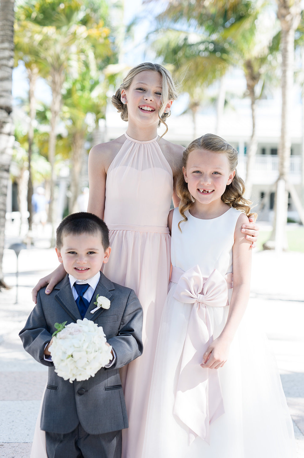 bridesmaid, flower girl and ring bearer outside of church