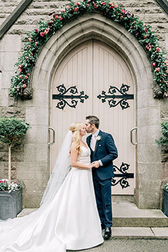 Ireland & US Wedding Coordinator, bride and groom kissing in front of double doors